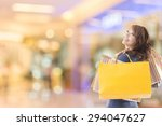 cheerful shopping woman of