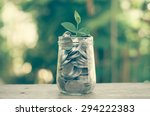 plant growing out of coins with ... | Shutterstock . vector #294222383