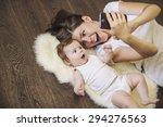 Woman With A Baby Doing A...