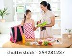 mother making breakfast for her ... | Shutterstock . vector #294281237