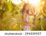 beauty girl outdoors enjoying... | Shutterstock . vector #294339557