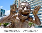 Small photo of VANCOUVER BC CANADA JUNE 15 2015: A-maze-ing Laughter is a 2009 bronze sculpture by Yue Minjun, located in Morton Park in Vancouver, British Columbia, Canada