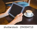 a woman using tablet computer... | Shutterstock . vector #294504713