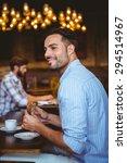 smiling businessman holding a... | Shutterstock . vector #294514967