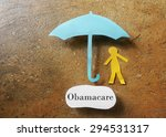 paper person under an obamacare ... | Shutterstock . vector #294531317