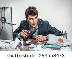 Small photo of Drunk businessman sitting drunk at office with computer holding glass looking depressed wearing loose tie in alcohol addiction problem concept