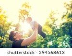 Happy Father Holding Little Ki...