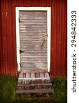 An Old Barn Door With A Vintag...