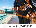 Small photo of Builder Worker in safety protective equipment on bridge construction