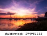Vibrant Harbor Sunset With Boats