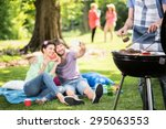 happy people doing grill in the ... | Shutterstock . vector #295063553