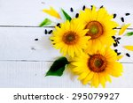 Sunflowers On A White Wooden...