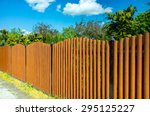 Long Brown Wooden Fence...