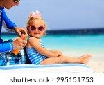 Father Applying Sunblock Cream...