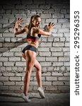 muscular woman on grey brick... | Shutterstock . vector #295296353