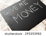 Small photo of Give me money on the blackboard