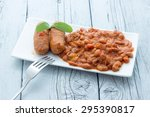 baked beans with sausages | Shutterstock . vector #295390817