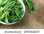 bowl of fresh spinach leaves on ...   Shutterstock . vector #295566047