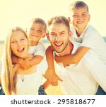 happy young family with two... | Shutterstock . vector #295818677