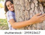 Pretty Brunette Hugging Tree O...