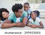 happy family lying on the floor ... | Shutterstock . vector #295925003