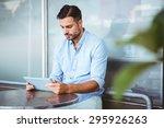 attentive businessman using a... | Shutterstock . vector #295926263