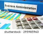 Small photo of Folder with label business administration and charts.