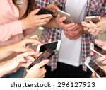 many hands holding mobile