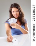 Small photo of Woman with playing cards, focus on ace of spades, isolated