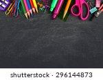 school supplies top border on a ... | Shutterstock . vector #296144873