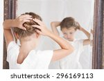 child or young girl fixing her... | Shutterstock . vector #296169113