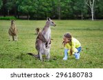 cute girl playing with kangaroo ...   Shutterstock . vector #296180783
