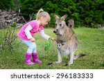 Little Girl Playing With...