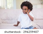 portrait of a little boy using... | Shutterstock . vector #296259407