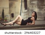 beautiful girl in a black dress ... | Shutterstock . vector #296403227