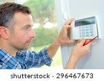 electrician fitting an... | Shutterstock . vector #296467673