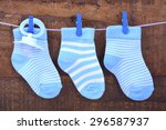 its a boy blue baby socks and... | Shutterstock . vector #296587937
