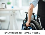 Woman In Wheelchair Next To An...