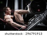 man in gym training at leg... | Shutterstock . vector #296791913