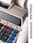 Small photo of Calculator, Adding Machine Tape, Tax.