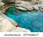 A View Of A Rocky Shore Of A...