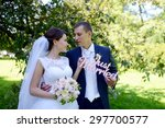 wedding couple on the nature is ... | Shutterstock . vector #297700577