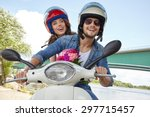 Cheerful Couple Riding Vintage...