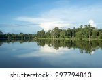 Scenic View Of Lake With Lush...