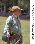 Small photo of MCCONNELLS, SC - July 11, 2015: American Revolutionary War reenactor during a recreation of the Battle of Huck's Defeat at Historic Brattonsville, originally fought nearby on July 12, 1780.