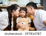 Parents Kissing Daughter With...