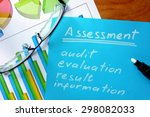 Small photo of Blue paper with word assessment and glasses.