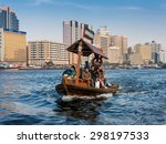 Small photo of DUBAI, UNITED ARAB EMIRATES (UAE): People crossing the Creek from Deira to Bur by abra, a traditional wooden water taxi in Dubai, United Arab Emirates