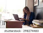 casual woman using laptop at... | Shutterstock . vector #298274483