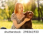 young girl with retriever on... | Shutterstock . vector #298361933